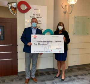 Orkin Canada President Rob Quinn and Canadian Blood Services Director of Philanthropy Margaret Miedema